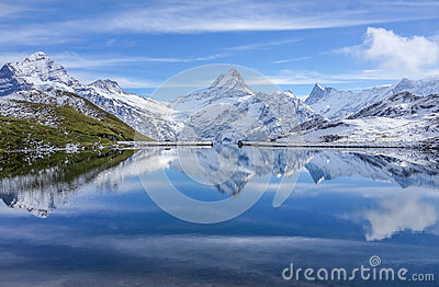 The snow mountain with reflection in lake and clear blue sky in Switzerland