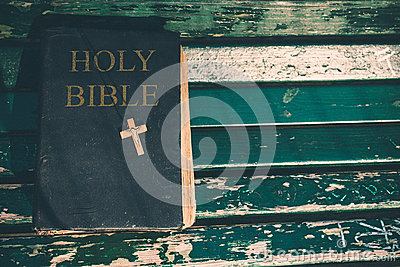 Vintage old holy bible book, grunge textured cover with