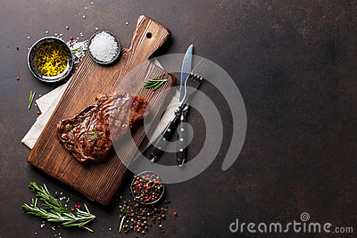 Grilled ribeye beef steak, herbs and spices