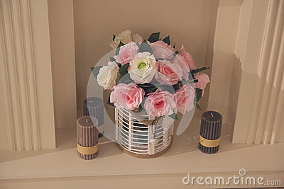Vase with roses and candles
