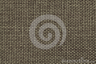 Green background with braided checkered pattern, closeup. Texture of the weaving fabric, macro.