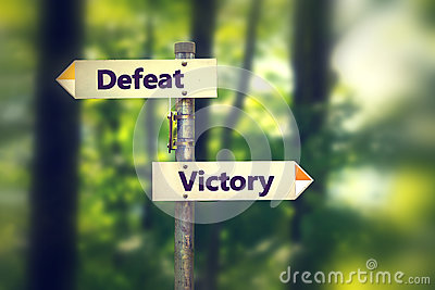 Signpost in a park with arrows pointing in opposite directions Victory and Defeat