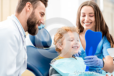Boy with dentist at the dental office