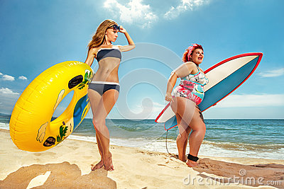 Fat woman with the surfboard