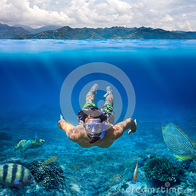 Underwater shoot of a young man snorkeling in a tropical sea on