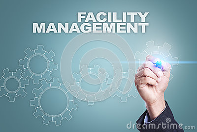 Businessman drawing on virtual screen. facility management concept