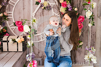Beautiful mother holding baby boy, mom carry cute child adorable small son, happy family picture, happiness concept