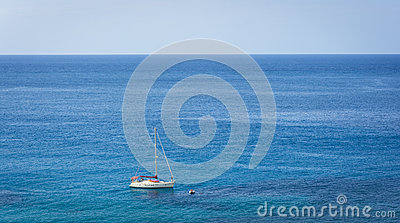 Sailing boat on blue mediterranean water in Ibiza island