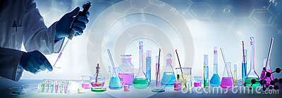 Analysis Laboratory - Scientist With Pipette And Beaker