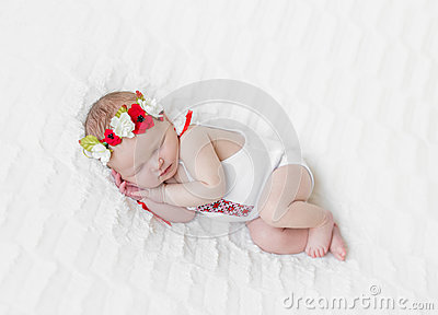 Baby girl in bright colorful hairband