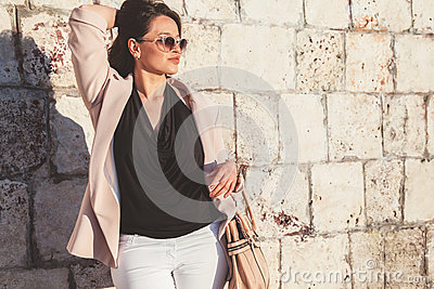 Plus size model wearing fashion clothes in city street
