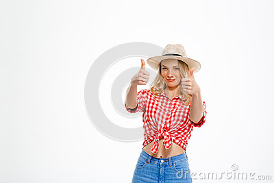 Portrait of beautiful country girl showing okay over white background.