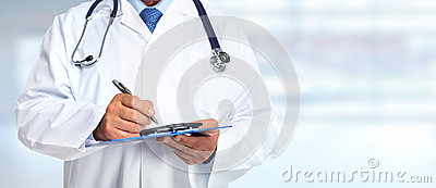Hands of medical doctor with clipboard.