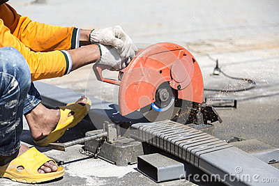 Worker cutting metal with unsafety position