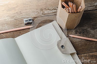 Blank daily planner notebook with pencils and pencil sharpener o