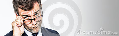 Long banner for pouting far-sighted businessman moving eyeglasses down