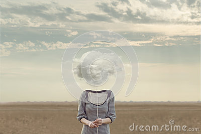 Woman`s head Replaced by a soft cloud in a surreal situation