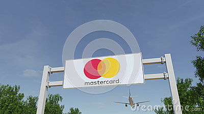 Airplane flying over advertising billboard with MasterCard logo. Editorial 3D rendering