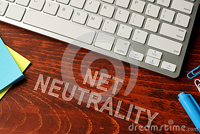 Net neutrality written on a wooden surface.