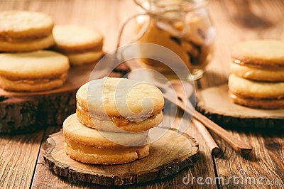 Caramel shortbread cookies on wooden background.
