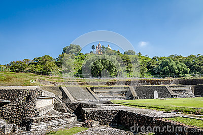Ruins of Cholula pyramid with Church of Our Lady of Remedies at