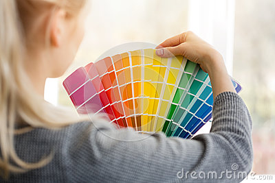 Woman designer choosing design color from swatch palett