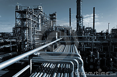 stock image of oil industry at night