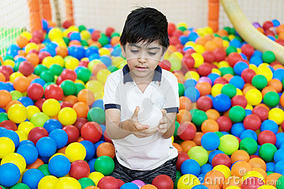 Boy in balls pool