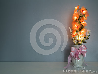 Electric flower in vase on table