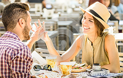 Young couple in love having fun at beer bar on travel excursion
