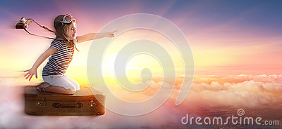 Little Girl On Suitcase In Trip Over Clouds