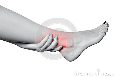 Closeup view of a young woman with pain on leg.