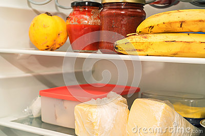 Open fridge with usual food