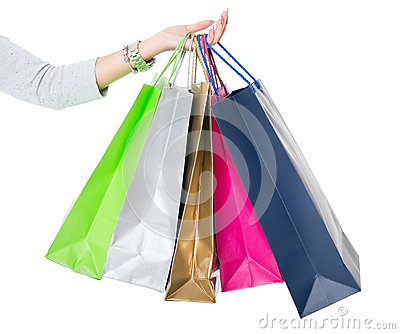 Shopping Bags. Female hand holding colorful shopping bags on white