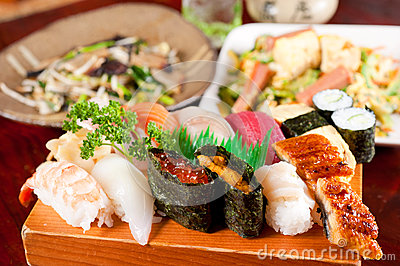 Delicious sushi with shrimp tuna, squiz and rice