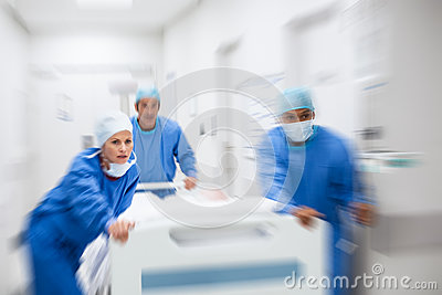 Doctors rushing patient to surgery