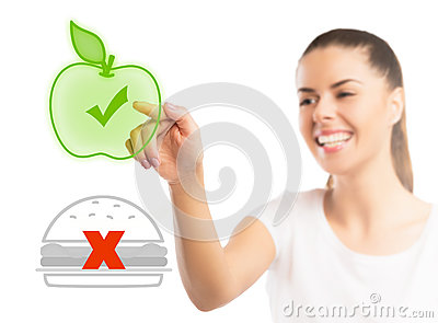 Beautiful woman choosing between healthy and unhealthy food
