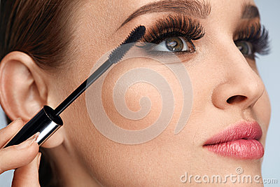 Woman With Makeup, Long Eyelashes Applying Mascara. Doing Makeup