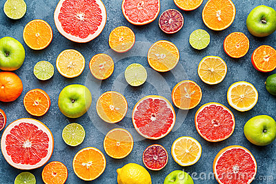 Citrus fruit pattern on grey concrete table. Food background. Healthy eating. Antioxidant, detox, dieting, clean eating