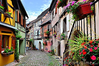 Colorful cobblestone lane in an Alsatian town, France