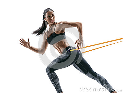 Strong woman using a resistance band in her exercise routine.