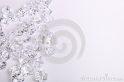 Scattered glass diamond chunks on a white background