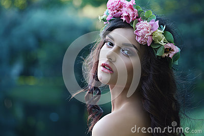 Romantic Woman with Peony Flowers Outdoors