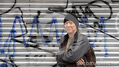 Asian senior traveler with urban grung graffiti background texture