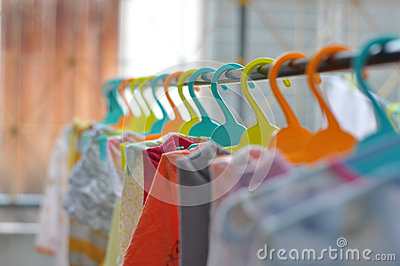 The colorful hangers are arranged in a neat and orderly manner.