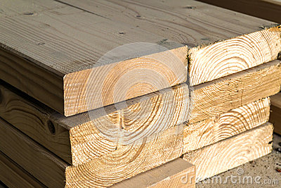Stack of new wooden studs at the lumber yard. Wood timber constr
