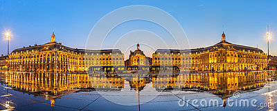 Iconic panorama of Place de la Bourse with tram and water mirror fountain in Bordeaux, France
