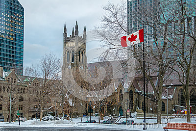 St. George`s Anglican Church at Canada Square with flag - Montreal, Quebec, Canada