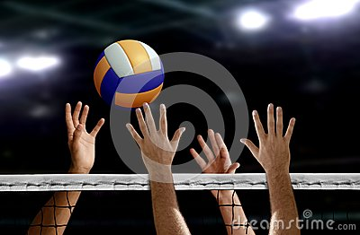 Volleyball spike hand block over the net