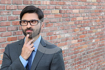 Cautious man taking a decision looking away with copy space